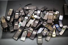 Stack of old mobile phones stock photography