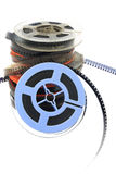 Stack of old movie film on plastic reel on white Stock Photo