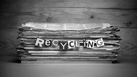Stack of old newspapers labeled recycling. stock images