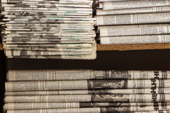 A stack of old newspapers lie on the shelf. A stack of old newspapers lie on a shelf in the archive Royalty Free Stock Photos