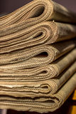 A stack of old newspapers on the shelf Royalty Free Stock Photo