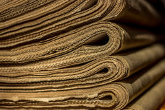 Stack of old newspapers on the shelf. closeup Royalty Free Stock Photos