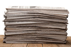 A stack of old newspapers on white background Royalty Free Stock Photography
