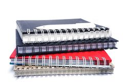 Stack of old note books and white pen Royalty Free Stock Image