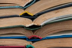 Stack of the old open books stock photo
