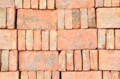 Stack of old orange bricks Stock Photos