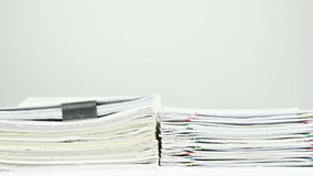 Stack old overload paperwork report on table time lapse stock video footage