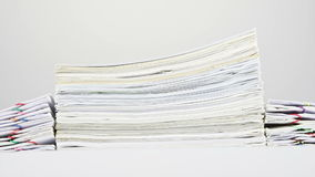 Stack old overload paperwork on table time lapse stock video footage