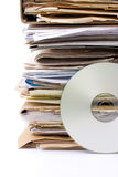 Stack of old paper files and modern cd archive. Old paper files and modern cd archive Stock Photos