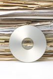 Stack of old paper files and  silver cd. Old paper files and modern cd archive Royalty Free Stock Image