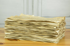 Stack of old paper sheets on wooden table Stock Images