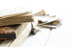 Stack of old photographs and photo album Royalty Free Stock Photo