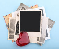Stack of old photos on blue background Stock Image