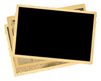 Stack of old photos,  free copy space. Stack of old photos, photo frame.yellowed and bleeched, free space for your pix, isolated on white Stock Images