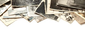 Stack old photos isolated on white background. Postcard rumpled and dirty vintage royalty free stock photo