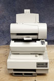 Stack of old printers Stock Photo