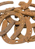 Stack of old retro horse shoes isolated on white Stock Image
