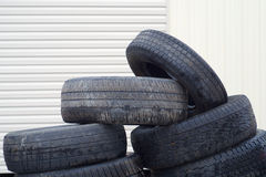 Stack of old rubber tires used wheels for recycling Royalty Free Stock Image
