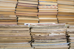 A stack of old school notebooks and a stack of textbooks or books.  royalty free stock images