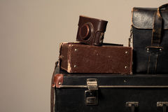 Stack of old shabby suitcase with a camera in bag Royalty Free Stock Photo