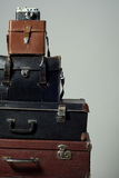 Stack of old shabby suitcases and camera Royalty Free Stock Images