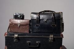 Stack of old shabby suitcases and camera Stock Photo