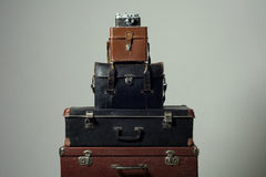 Stack of old shabby suitcases and camera Stock Images