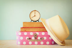 Stack of old suitcase, books and vintage clock Royalty Free Stock Photo