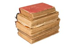 A stack of old tattered books. Vintage torn books. Antiques isolated. Royalty Free Stock Photography