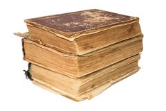 A stack of old tattered books. Vintage torn books. Antiques isolated. Stock Photo