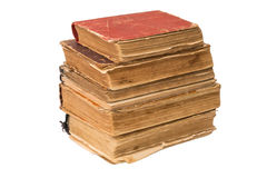 A stack of old tattered books. Vintage torn books. Antiques isolated. Stock Photos