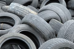 Stack of old tires. Old abandoned and used tires waiting for recycling Royalty Free Stock Photo