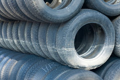 Stack of old tires. Stack of old and worn tires or tyres stock photos