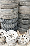 Stack of old tires and metallic rims Royalty Free Stock Image