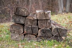 Stack of old and used wooden railway sleeper or tie. Stack of old and used wooden railway sleepers or ties. Railway construction material and parts Royalty Free Stock Image