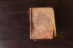 Stack of old vintage books on brown wooden background Royalty Free Stock Image