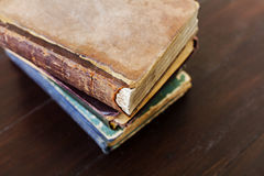 Stack of old vintage books on dark wooden background Royalty Free Stock Images