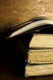 Stack of Old, Vintage Books with One Open Book Royalty Free Stock Photos