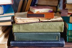 Stack of old vintage books on wooden shelf in university library. For reading royalty free stock images