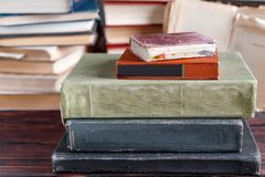 Stack of old vintage books on wooden shelf in university library. For reading royalty free stock photos