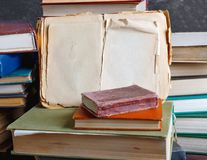 Stack of old vintage books on wooden shelf in university library. For reading royalty free stock photography