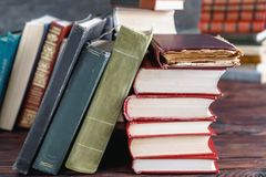 Stack of old vintage books on wooden shelf in university library. For reading royalty free stock photo