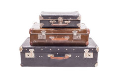 Stack of old vintage suitcases isolated. Vintage old suitcases isolated on white background Royalty Free Stock Images