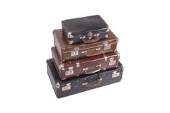 Stack of old vintage suitcases isolated on white. Vintage old suitcases isolated on white background Royalty Free Stock Photography