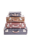 Stack of old vintage suitcases isolated on white. Vintage old suitcases isolated on white background Royalty Free Stock Images