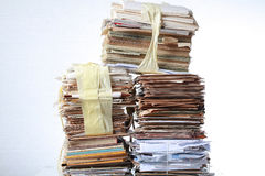 Stack old of waste paper staked recycle. A stack of waste paper and staked recycle Royalty Free Stock Photo