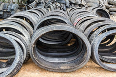 Stack of old wheel black tyre. Royalty Free Stock Photos