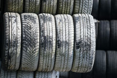 Stack of old wheel black tyre texture background Stock Image
