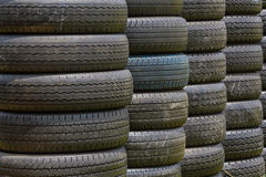 Stack of old wheel black tyres. royalty free stock photo