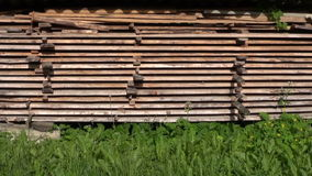 Stack old wooden boards planks in farm yard stock video footage